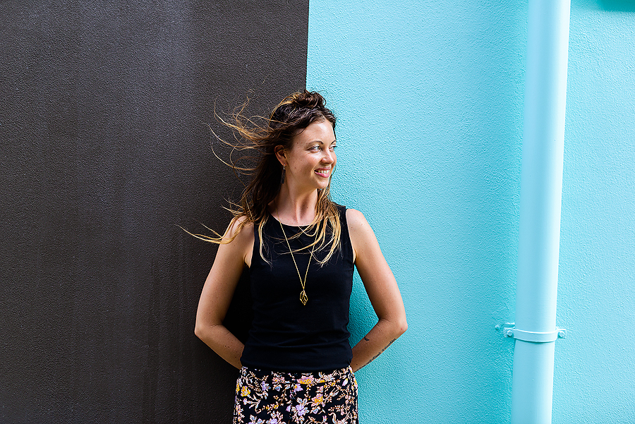 Lady smiling against blue and black branding photography by Sunshine Coast photographer Elise Gow