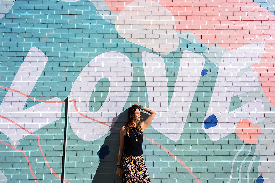 Lady standing against love wall for personal branding photogaphy by Sunshine Coast photographer Elise Gow